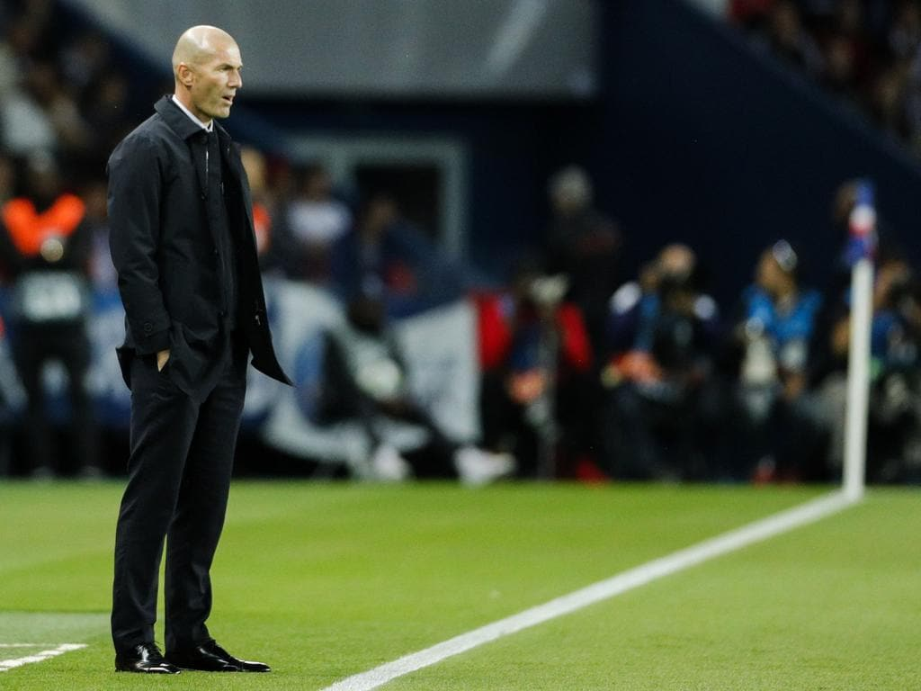 Real Madrid's French coach Zinedine Zidane reacts during the UEFA Champions league Group A football match between Paris Saint-Germain and Real Madrid, at the Parc des Princes stadium, in Paris, on September 18, 2019. (Photo by GEOFFROY VAN DER HASSELT / AFP)