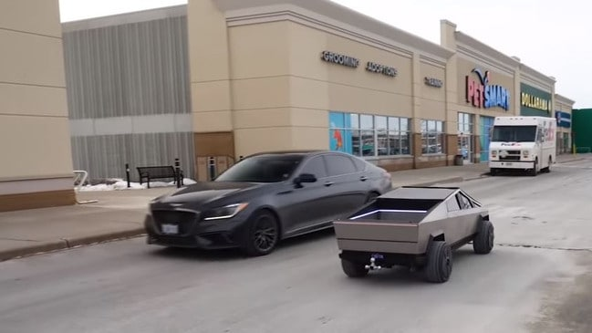 The scale model Cybertruck is dwarfed by a regular sedan. Picture: Hacksmith Industries