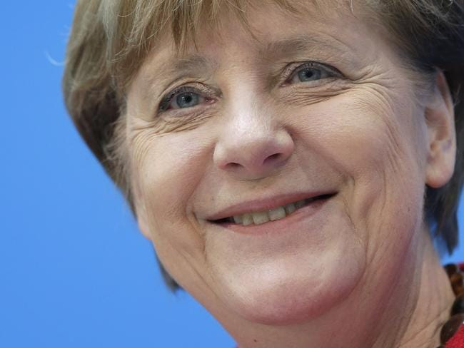 German Chancellor Angela Merkel has said she will not change her migrant policy, which has seen more than 1.1 million people enter the country in the last year. Picture: AP Photo/Michael Sohn.
