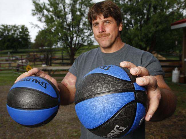 This strongman's capable of holding a basketball in each hand. Picture: Caters News/Picture Media