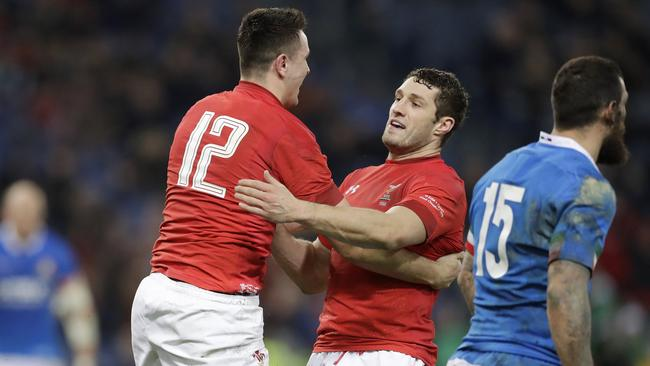 Wales' Owen Watkin, left, celebrates with his teammate after scoring a try.