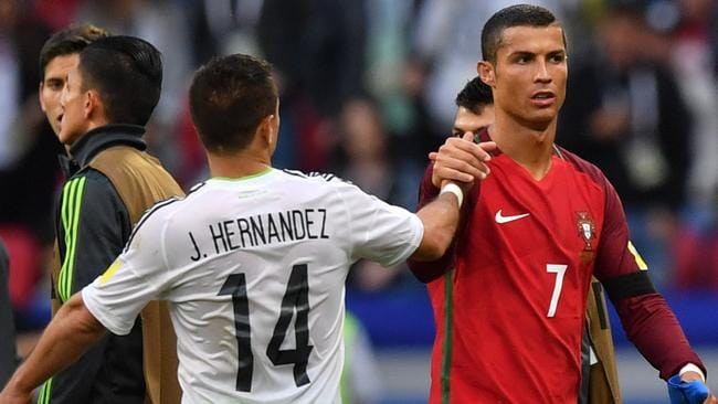 Mexico's forward Javier Hernandez (L) shakes hands with Portugal's forward Cristiano Ronaldo