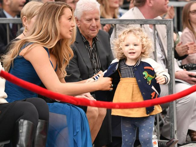 Little James was clearly excited by the crowd. Picture: Splash News Australia