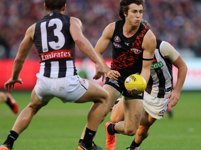 Essendon's Andrew McGrath clears from the congestion.
