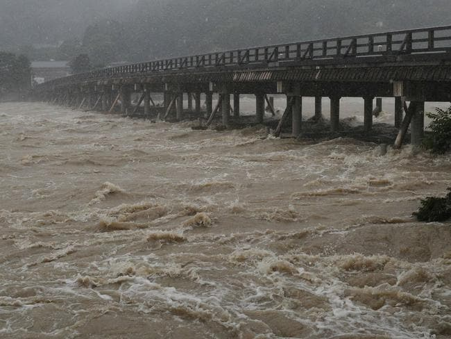 The Togetsu bridge on the Katsura river in Kyoto during heavy rains in western Japan. Picture: AFP