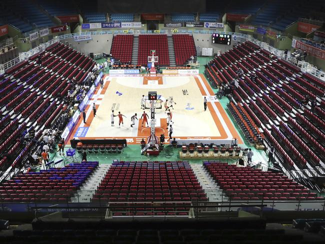 A basketball game in South Korea is played without fans in a bid to stop the virus spreading. Picture: Yun Tai-hyun/Yonhap via AP.
