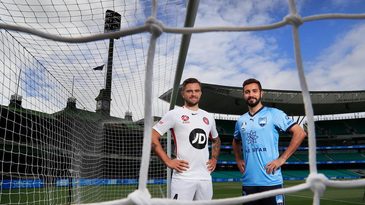 Josh Risdon of the Wanderers and Michael Zullo of Sydney FC pose ahead of the Sydney Derby