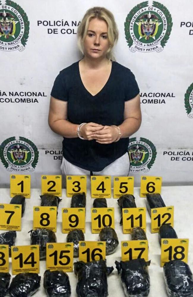 Sainbury pictured with the drugs found in her suitcase. Picture: AFP/Colombia Anti-Narcotics Police