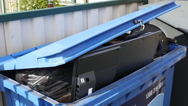 A TV in a bin the Footscray residence. Picture: David Crosling