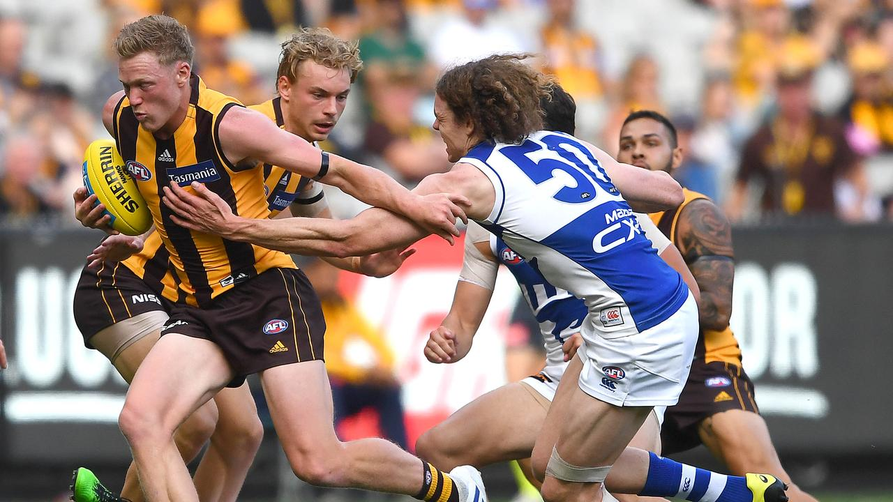 Ben Brown attempts a tackle in North Melbourne's Round 3 match. Photo: Quinn Rooney/Getty Images.