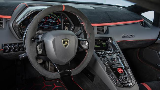 The Aventador's cockpit resembles a fighter jet's.