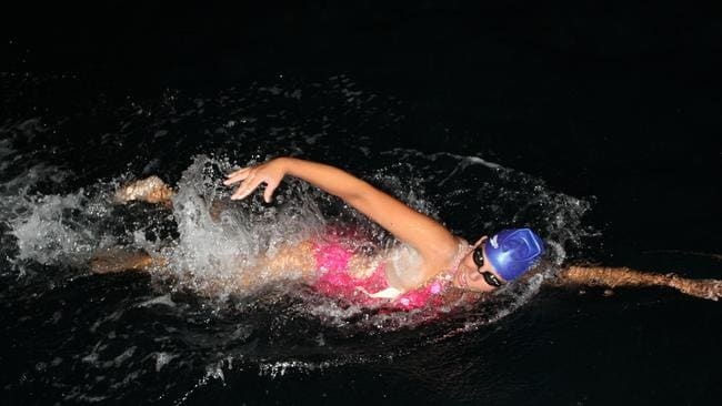 Chloe McCardel swims through the night. Picture: supplied