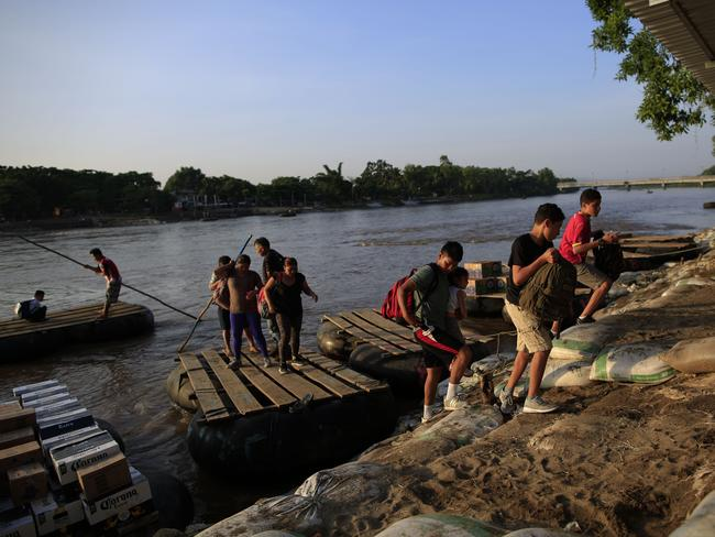 Migrants arriving from Guatemala disembark from a raft in Ciudad Hidalgo, Mexico. Picture: AP
