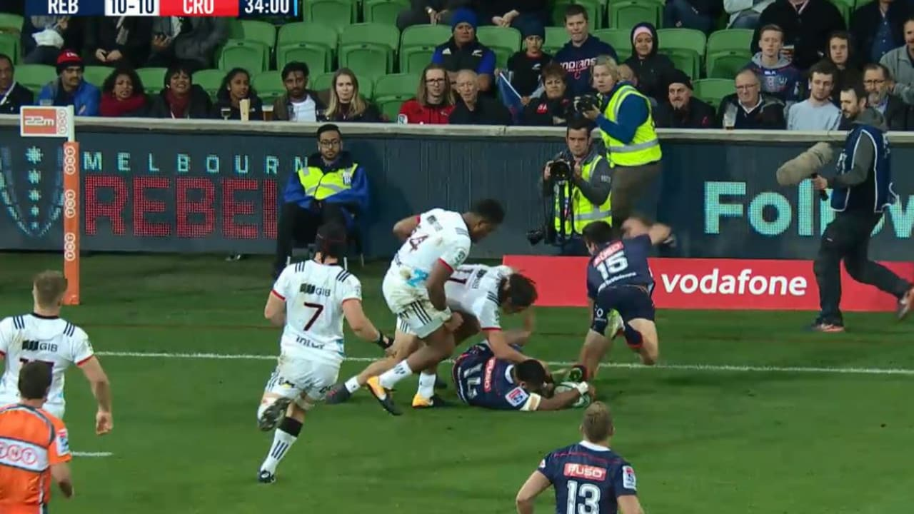 Crusaders winger Seta Tamanivalu pushes Rebels fullback Jack Maddocks illegally off the ball.