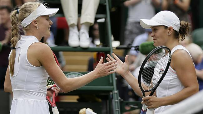 Australia's Ashleigh Barty, right, greets Britain's Harriet Dart at the net after winning their Women's singles match during day six of the Wimbledon Tennis Championships in London, Saturday, July 6, 2019. (AP Photo/Tim Ireland)