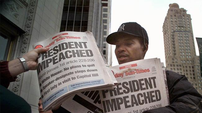 R C Stewart selling newspapers carrying the headline 'President Impeached'.
