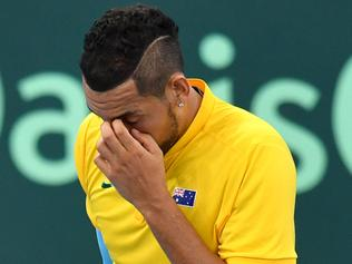 Nick Kyrgios of Australia is seen reacting against Alexander Zverev of Germany during the World Group first round match of the Davis Cup between Australia and Germany played at Pat Rafter Arena in Brisbane, Sunday, February 4, 2018. (AAP Image/Darren England) NO ARCHIVING, EDITORIAL USE ONLY
