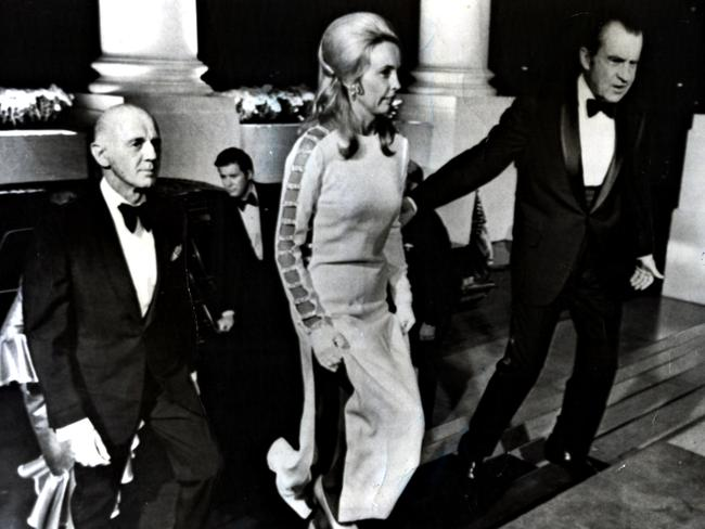 US president Richard Nixon (R) escorts Sonia McMahon wearing 'that' dress and husband, Prime Minister William McMahon to a function at the White House in 1971.
