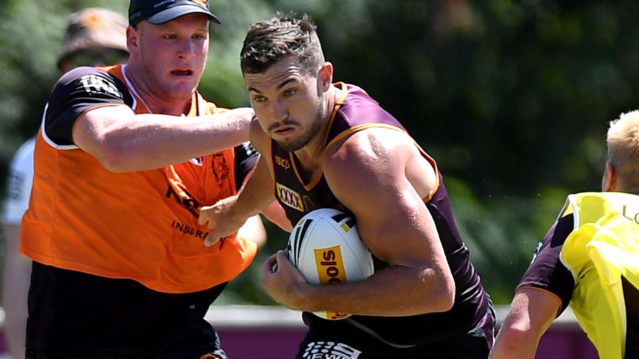 Corey Oates takes on the defence during a Brisbane training session.