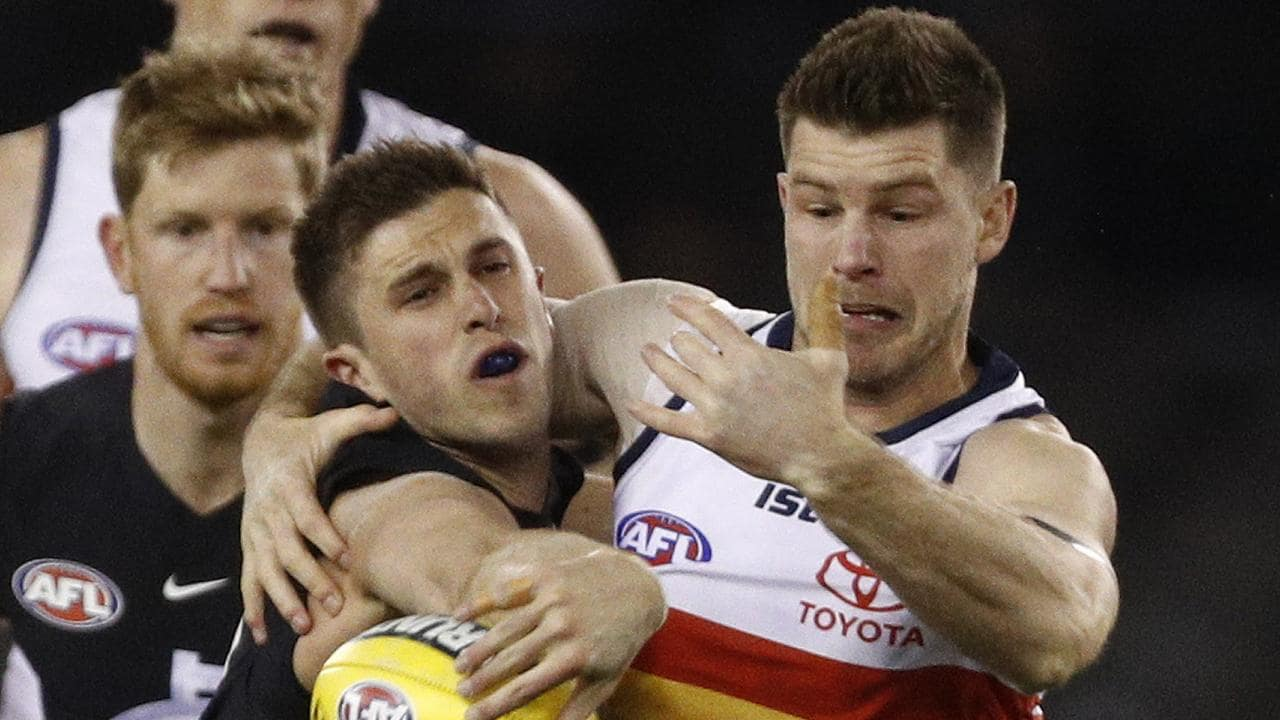 Marc Murphy of the Blues and Bryce Gibbs of the Crows. Picture: Daniel Pockett