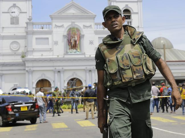 Sri Lankan Army soldiers secure the area after a blast in Colombo, Sri Lanka, Sunday. More than two hundred people were killed and hundreds more injured. Picture: AP Photo