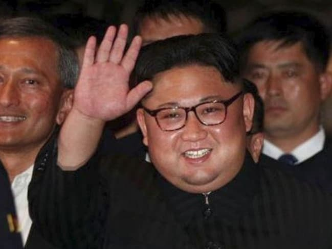 Kim Jong-un greets onlooks after he arrived at a Singapore hotel. Picture: Reuters