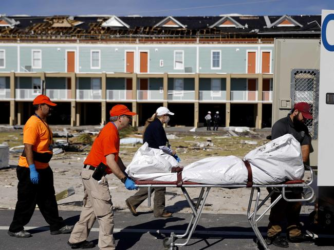 A body is removed after being discovered during the search of a housing structure in the aftermath of hurricane Michael in Mexico Beach, Florida. Picture: AP