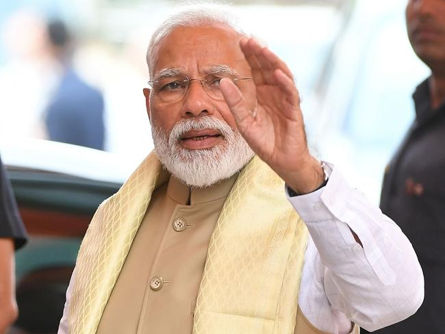 Bharatiya Janata Party (BJP) leader and Indian Prime Minister Narendra Modi gestures on his arrival at BJP headquarters. Picture: AFP