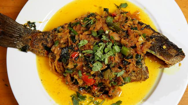 Black fish a Bengali dish of pan fried fish with garlic, ginger, onion, shallots, coriander and cumin from Khushboo Sweets & Restaurant in Lakemba. Picture: Jonathan Ng