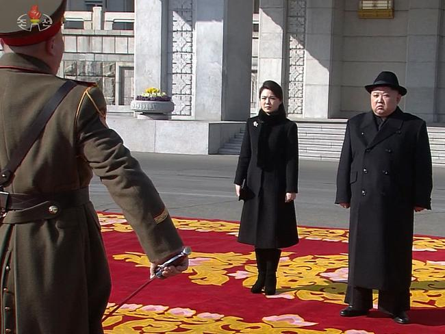 North Korean leader Kim Jong Un and his wife Ri Sol Ju attend a military parade in Kim Il Sung Square in Pyongyang. Picture: KCTV