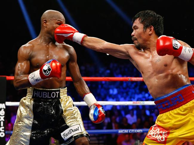 Manny Pacquiao throws a right at Floyd Mayweather Jr. during their bout on Sunday.