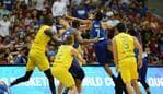 TOPSHOT - Philippine and Australian players engage in a brawl during their FIBA World Cup Asian qualifier game at the Philippine arena in Bocaue town, Bulacan province, north of Manila on July 2, 2018. Australia won by default 89-53. / AFP PHOTO / TED ALJIBE