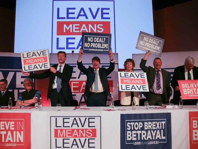 Conservative MPs hold up signs with slogans at a political rally organised by the pro-Brexit Leave Means Leave campaign group. Picture: AFP