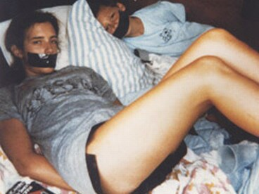 The mysterious photo of two children bound with their mouths taped shut was discovered in a convenience store car park a year after Tara Calico went missing. Picture: AP