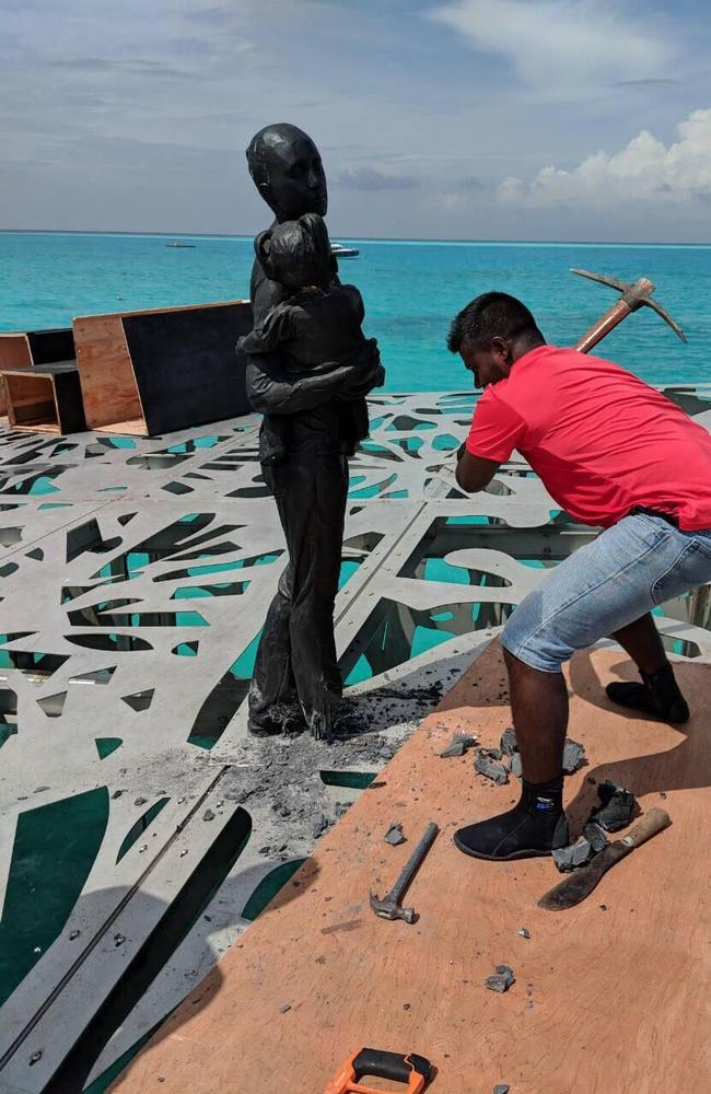 A pickaxe is taken to one of Jason DeCaires Taylor's artworks. Picture: Maldives Police