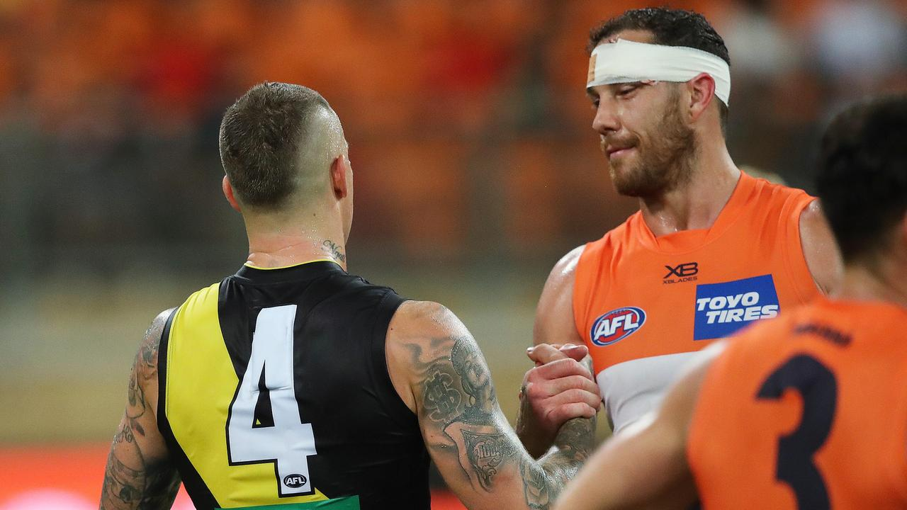 Richmond's Dustin Martin and Giants Shane Mumford shook hands at full-time. Picture: Phil Hillyard