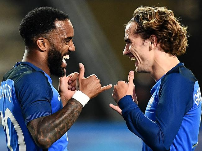 France's forward Antoine Griezmann with Alexandre Lacazette.