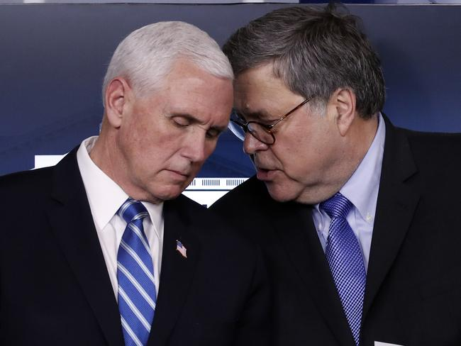 Vice President Mike Pence listens to Attorney-General William Barr as President Donald Trump speaks about the coronavirus. Picture: AP