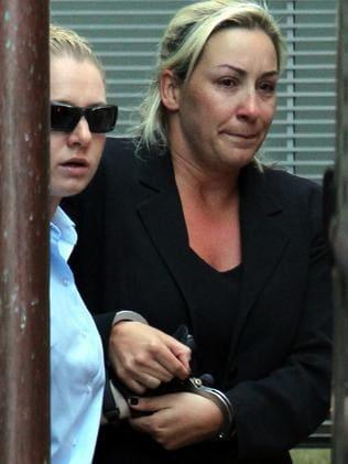 Keli Lane in handcuffs in 2010.