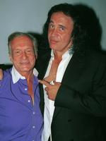 Kiss bassist Gene Simmons poses with Playboy founder, Hugh Hefner during the Tongue Magazine Fall 2002 Issue release party at Barfly on September 27, 2002 in West Hollywood, California. Picture: Getty