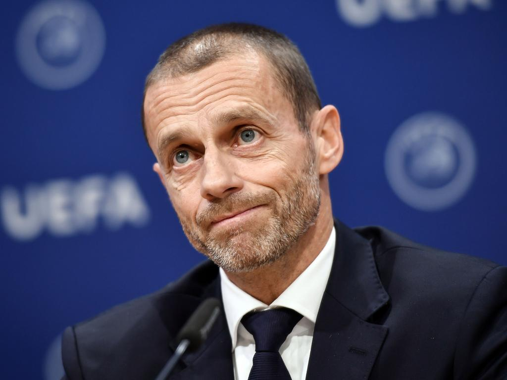 (FILES) In this file photo taken on December 4, 2019 UEFA president Aleksander Ceferin holds a press conference following a meeting of the executive committee at the UEFA headquarters, in Nyon, Switzerland. - The 2020 European Championship will be the first to be played all across the continent, with 12 different countries hosting matches, forcing teams and supporters to rack up thousands of air miles and leave behind a gigantic carbon footprint. (Photo by Fabrice COFFRINI / AFP)
