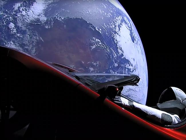 SpaceX CEO Elon Musk's cherry red Tesla roadster after the Falcon Heavy rocket delivered it into orbit around the Earth. Picture: AFP