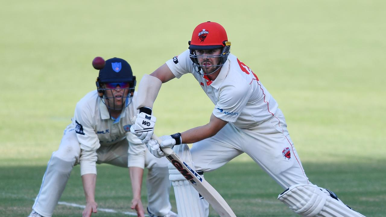 Travis Head bounced back in style with a century against New South Wales.