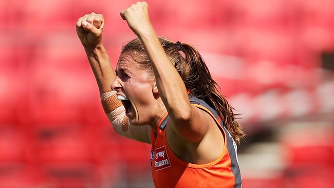 Aimee Schmidt celebrates a goal during the narrow loss. Picture: AFL Photos/Getty Images