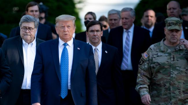 General Milley walked alongside US Attorney General William Barr (L) and US Secretary of Defence Mark Esper (C). Picture: Brendan Smialowski/AFP