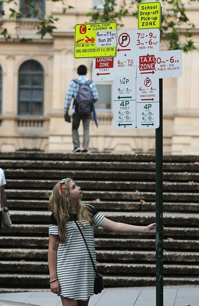 Kiwi visitor Ellie Ball is baffled by the Bathurst St signage. Picture: Britta Campion