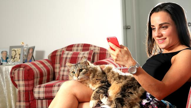 Silvana Karzon uses her mobile to access super at home. PICTURE: Stephen Cooper.