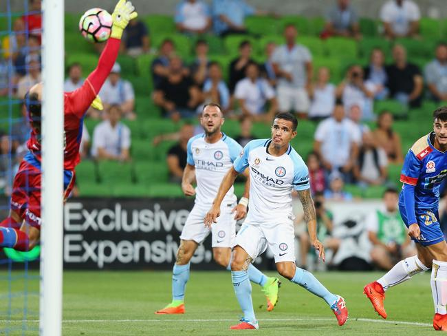 Tim Cahill of the City scores off Josh Rose's cross.