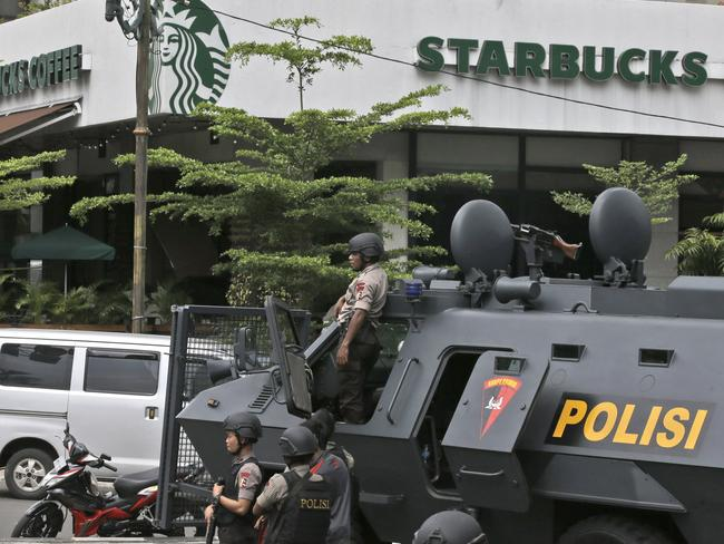 Jakarta blast ... a police armoured vehicle is parked outside a Starbucks cafe after attackers set off explosions. Picture: AP.
