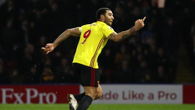 Troy Deeney of Watford reacts after scoring the first goal.
